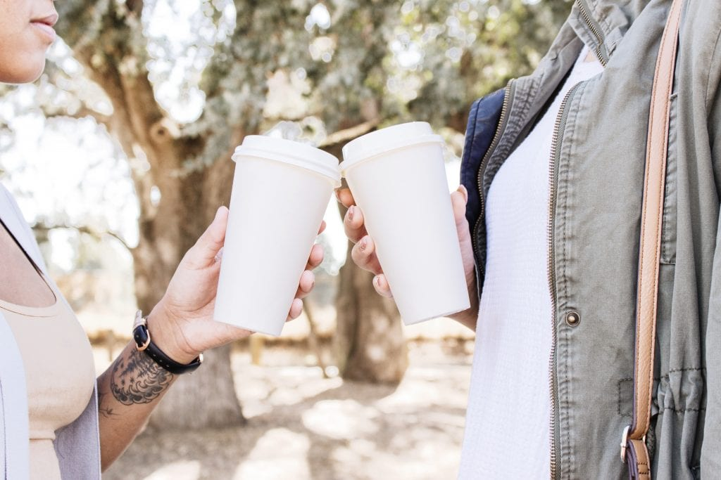 two friends drinking coffee