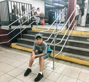 Young boy waiting in NYC Subway station