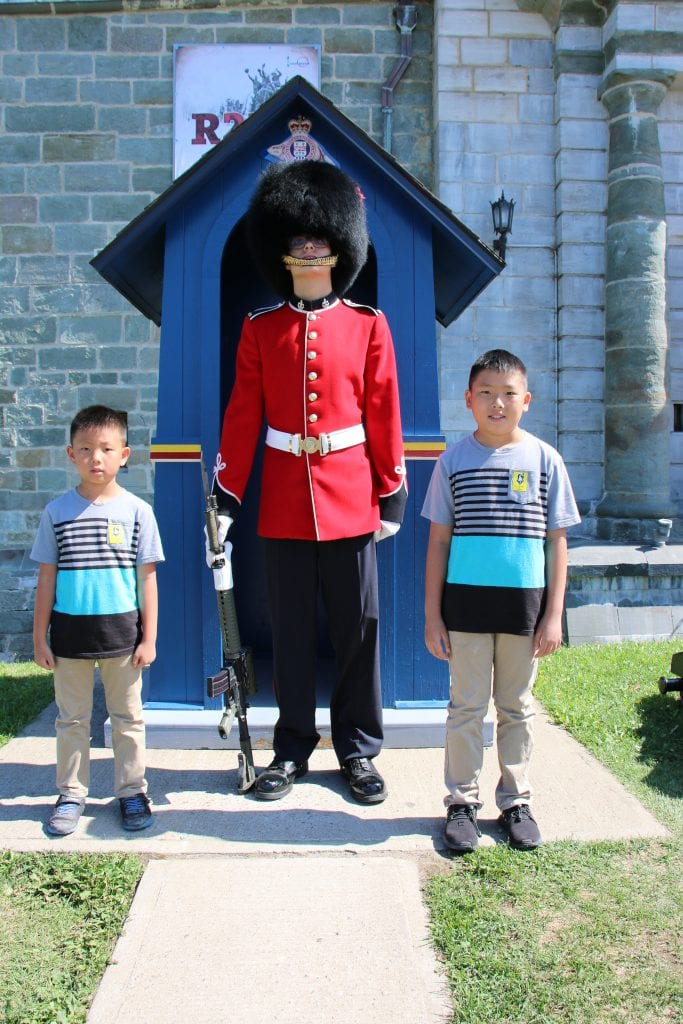 Quebec City with kids - boys with guard at La Citadelle de Quebec